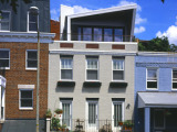 Row House Features DC's First Solar Chimney