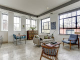 Best New Listings: A Designer's One-Bedroom; Life in a Former Auto Garage
