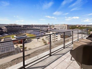 Move In To The Ballpark District's Hottest Condo and Get The Best Views of Summer Baseball